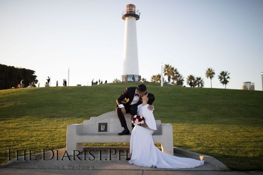 Kissing by the lighthouse on Long Beach