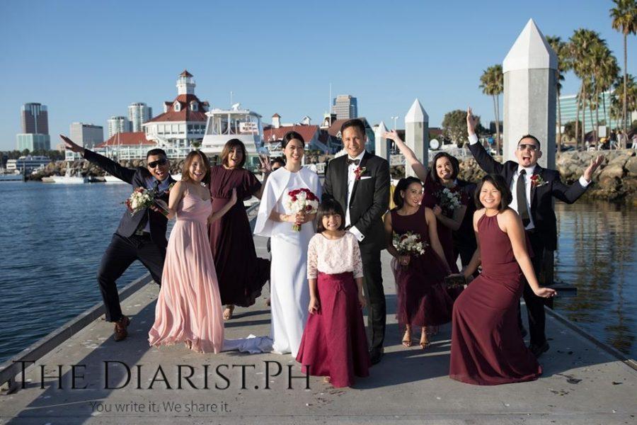 The wedding entourage hams it up.